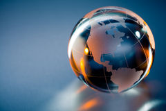 Glass globe of Planet Earth. Three dimensional illustration of glass Planet Earth globe with north and south America in foreground Royalty Free Stock Images