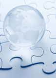 Glass globe with puzzle background Stock Image
