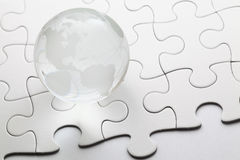 Glass globe with puzzle background Stock Images