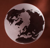 Glass Globe with red background. Polar view of a glass earth globe with red background royalty free stock image