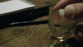 Glass globe. Spining globe with the hand stock footage