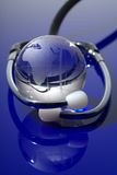 Glass globe with stethoscope Stock Image