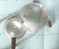 Glass globe and stethoscope over the ECG trace, concept of diagn Royalty Free Stock Images