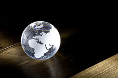 Glass globe on table Stock Image