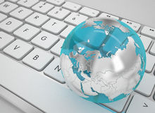 Glass globe on white keyboard. 3d high quality render Royalty Free Stock Image