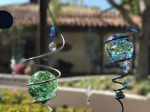 Glass globes in lawn ornament