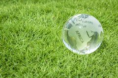 Glass Globe on Green Grass stock photo
