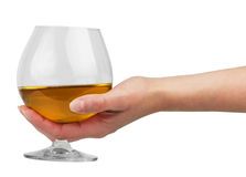 Glass goblet with brandy in hand Royalty Free Stock Photography