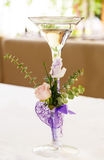 Glass goblet and flowers Royalty Free Stock Image