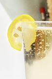 Glass goblet with sparkling lemonade and lemon Royalty Free Stock Photo