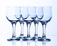 Glass goblets. On light background Royalty Free Stock Images