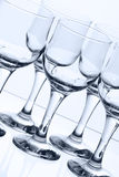 Glass goblets. On light background Royalty Free Stock Photos