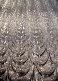Glass Goblets Background. Rows and rows of shiny glass goblets, creating an interesting background Royalty Free Stock Photo