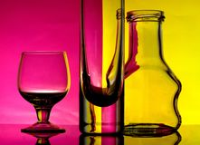 Glass goblets on a colored background Stock Photos