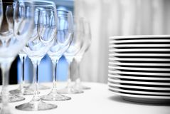 Glass goblets and plates Stock Photography