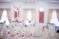Glass goblets. Pyramid of champagne. The hill glasses wine and cherries. for alcohol. Festive drink. Bartender show Royalty Free Stock Photography