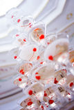 Glass goblets. Pyramid of champagne. The hill glasses wine and cherries. for alcohol. Festive drink. Decorations the Stock Images
