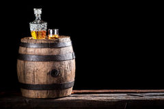 Glass of golden aged brandy or whiskey on the rocks Royalty Free Stock Images