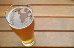 Glass of golden beer Royalty Free Stock Image