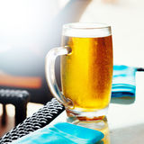 Glass of golden draft beer Royalty Free Stock Image