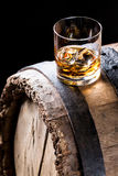 Glass of good whisky with ice in the distillery basement Royalty Free Stock Images