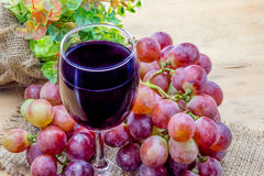 Glass of grape juice Stock Images