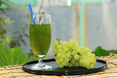 Glass of grape and juice Royalty Free Stock Images