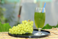 Glass of grape juice Stock Photography
