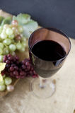 Glass of grape juice on sackcloth Stock Images
