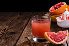 Glass with Grapefruit Juice Stock Image
