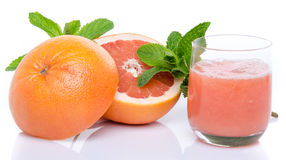 Glass of grapefruit juice with fresh grapefruits and mint Stock Photos