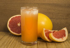 A glass of grapefruit juice with ice Royalty Free Stock Photo