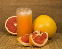 A glass of grapefruit juice with ice Stock Images