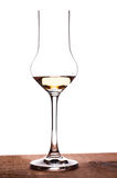 Glass with grappa in backglight Royalty Free Stock Photography