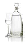 Glass of grappa with a bottle Royalty Free Stock Images