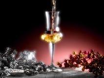 Glass of grappa. Poured, Christmas theme Stock Image
