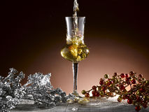 Glass of grappa. Poured, Christmas theme Royalty Free Stock Images