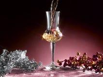 Glass of grappa. Poured, Christmas theme Stock Photography