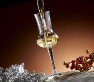 Glass of grappa. Poured, Christmas theme Royalty Free Stock Photography