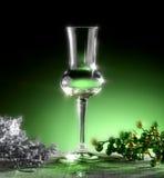 Glass of grappa. Poured, Christmas theme Royalty Free Stock Photo