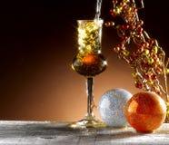 Glass of grappa. Poured, Christmas theme Stock Photo