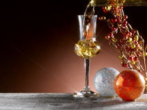 Glass of grappa. Poured, Christmas theme Stock Images