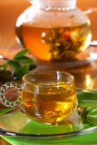 Glass of greean tea and teapot Royalty Free Stock Photos