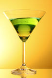 Glass with a green alcoholic beverage Stock Images