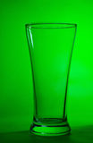 Glass on green background Stock Photography