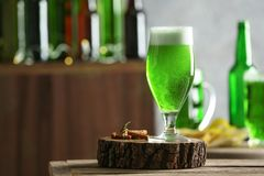 Glass of green beer on table in bar.  Saint Patrick`s day celebration. Glass of green beer on table in bar. Saint Patrick`s day celebration Royalty Free Stock Images