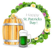 Glass of green beer and wooden barrel Stock Photo