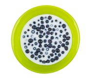 Glass green bowl with blueberry and milk isolated on white Stock Photography