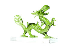 Glass green dragon isolated on white background. Glass green traditional chinese dragon isolated on white background. Feng Shui statuette Royalty Free Stock Image