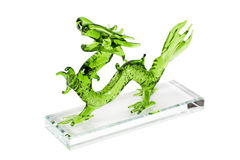 Glass green dragon isolated on white background. Glass green traditional chinese dragon isolated on white background. Feng Shui statuette Royalty Free Stock Photos
